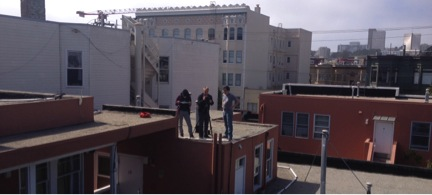 Members of the team connecting WiFi access points on top of Clara House.