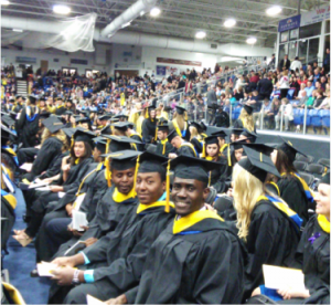 Michelet Guerrier (front) at his Graduation Ceremony in Michigan.