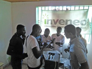 Teachers gather together to send and receive files via Bluetooth. Photo credit: Michelet Guerrier - Inveneo