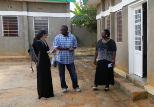 Inveneo's Jill Costello (left) meets with community members to discuss details on an United Methodist Communications project for DRCongo.