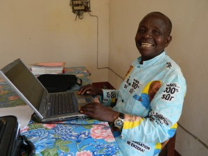 A happy computer user in the DR Congo.